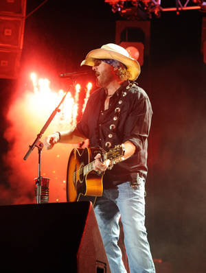 Photo - Norman resident Toby Keith performs Aug. 11 at Red Rock Resort and Casino in Las Vegas.  AP ARCHIVES PHOTO