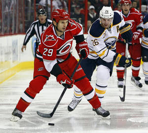 photo - Carolina Hurricanes' Tim Wallace (29) works the puck with Buffalo Sabres' Thomas Vanek (26), of Austria, nearby during the second period of an NHL hockey game, Tuesday, March 5, 2013, in Raleigh, N.C. (AP Photo/Karl B DeBlaker)