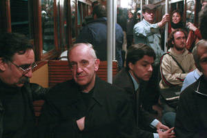 Photo - In this 2008 photo, Argentina's Cardinal Jorge Mario Bergoglio, second from left, travels on the subway in Buenos Aires, Argentina. Bergoglio, named pope on Wednesday, was known for taking the subway and mingling with the poor of Buenos Aires while archbishop. Bergoglio chose the name Pope Francis and is the first pope ever from the Americas. <strong>Pablo Leguizamon - AP</strong>