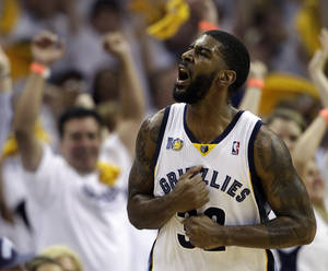 Photo - Memphis Grizzlies guard O. J. Mayo yells after a score against the Oklahoma City Thunder during the second half of Game 4 of a second-round NBA basketball playoff series on Monday, May 9, 2011, in Memphis, Tenn. (AP Photo/Wade Payne)