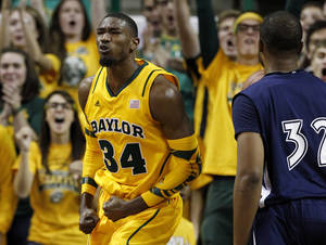 Photo -   Baylor forward Cory Jefferson (34) celebrates in front of Jackson State 's Willie Readus (32) after dunking during the first half of an NCAA college basketball game, Sunday, Nov. 11, 2012, in Waco, Texas. (AP Photo/Tony Gutierrez)