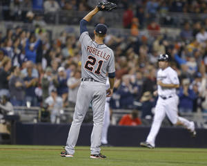 Photo - Detroit Tigers starting pitcher Rick Porcello watches San Diego Padres' Seth Smith head home on Chase Headley's home run off Porcello in the sixth inning of a baseball game Friday, April 11, 2014, in San Diego. (AP Photo/Lenny Ignelzi)