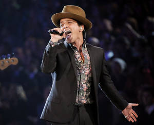 Photo - FILE - In this Nov. 7, 2012 file photo, Bruno Mars performs during the 2012 Victoria's Secret Fashion Show in New York. Mars will perform at this year's Super Bowl. (Photo by Evan Agostini/Invision/AP)