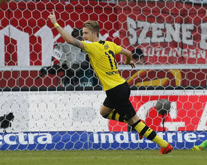 Photo - Dortmund's Marco Reus celebrates his side's third goal during a soccer match of German Bundesliga between VfB Stuttgart and Borussia Dortmund in Stuttgart, Germany, Saturday, March 29, 2014. (AP Photo/Michael Probst)