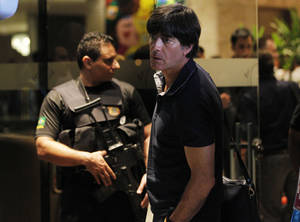 Germany's coach Joachim Loew arrives with his team to the Sheraton Hotel in Rio de Janeiro, Brazil, Friday, July 11, 2014. Germany will face Argentina at the World Cup final Match on Sunday. (AP Photo/Leo Correa)
