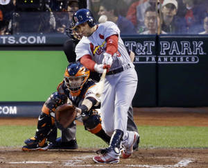 photo -   St. Louis Cardinals&#039; Carlos Beltran hits a two-run home run during the fourth inning of Game 1 of baseball&#039;s National League championship series against the San Francisco Giants Sunday, Oct. 14, 2012, in San Francisco. (AP Photo/Mark Humphrey)  