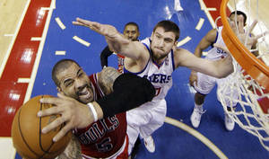 Photo -   Chicago Bulls' Carlos Boozer (5) shoots as Philadelphia 76ers' Spencer Hawes defends in the first half of Game 6 in an NBA basketball first-round playoff series, Thursday, May 10, 2012, in Philadelphia. (AP Photo/Matt Slocum)