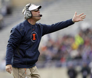 Photo -   Illinois head coach Tim Beckman reacts to a call during the first half of an NCAA college football game against Northwestern in Evanston, Ill., Saturday, Nov. 24, 2012. (AP Photo/Nam Y. Huh)