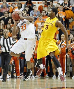 photo - Oklahoma State Cowboys' Marcus Smart (33) shoots a shot at the buzzer past mid court over Iowa State Cyclones' Melvin Ejim (3) during the college basketball game between the Oklahoma State University Cowboys (OSU) and the Iowa State University Cyclones (ISU) at Gallagher-Iba Arena on Wednesday, Jan. 30, 2013, in Stillwater, Okla.  Photo by Chris Landsberger, The Oklahoman