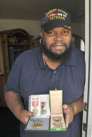 Photo - Michael Thomas and medals he received for his military service. (Lawton Constitution photo)