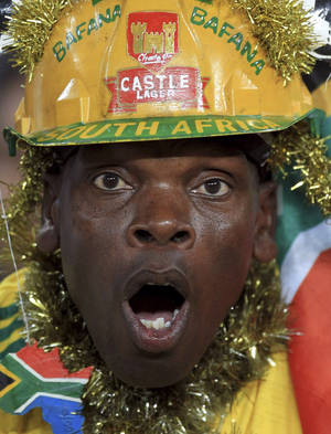 "Photo - File - In this Tuesday, Nov. 19, 2013 file photo a supporter of the South African national  soccer team team attends a match  against Spain in Johannesburg.  The team has been described as ""a bunch of losers"" by the sports minister after being eliminated in the group stage of the lower-level African Nations Championship. (AP Photo/Themba Hadebe, file)"