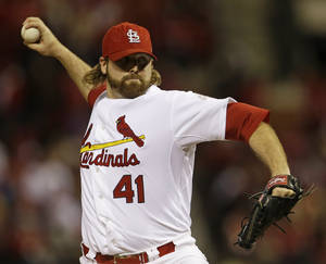 photo -   St. Louis Cardinals relief pitcher Mitchell Boggs throws during the eighth inning of Game 5 of baseball's National League championship series against the San Francisco Giants, Friday, Oct. 19, 2012, in St. Louis. (AP Photo/Jeff Roberson)