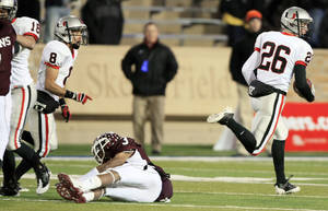 Photo - Union senior Thomas Roberson, right, outruns the last man to beat, Jenks' Devin Pugh, as he takes the opening kickoff for a touchdown Friday. Photo by STEPHEN HOLMAN, Tulsa World