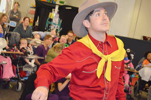Photo - Matthew Alvin Brown portrays Will Rogers during a performance by Lyric Theatre actors at The Children's Center in Bethany. PHOTO BY TRAVIS DOUSSETTE, THE CHILDREN'S CENTER <strong></strong>