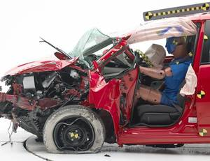 Photo - This undated photo provided by the Insurance Institute for Highway Safety shows he Honda Fit during a crash test. The agency says the Fit and Fiat 500 were the worst performers of  the 12 minicars tested in terms of potential injury to drivers. (AP Photo/Insurance Institute for Highway Safety)