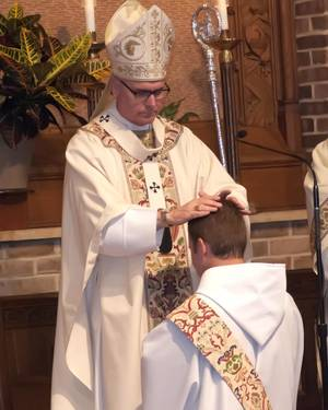 Photo - The Most Rev. Paul S. Coakley, archbishop of the Archdiocese of Oklahoma City, ordains the Rev. Simeon Spitz to the Roman Catholic priesthood during a May 31 ceremony at St. Gregory's Abbey in Shawnee.   Photo by Vincent R. Vitale <strong></strong>