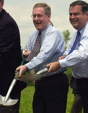 Photo - FILE -In this Monday July 2, 2001, file photo, U.S. Secretary of Energy Spencer Abraham, right, and U.S. Sen. Mitch McConnell participate in a groundbreaking ceremony for a new power plant which will use clean coal technology, near Hindman, Ky. President Barack Obama's new plan to impose stricter federal emissions standards on coal-fired power plants has drawn sharp criticism from McConnell. Kentucky is among the nation's top coal producers. (AP Photo/James Crisp, File)