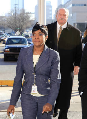Photo - Oklahoma County District Judge Tammy Bass-LeSure arriving at the Oklahoma County Jail to turn herself in this morning to be fingerprinted and have her photo taken in Oklahoma City Monday, Jan. 24, 2011. Photo by Paul B. Southerland, The Oklahoman