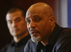 Photo - Tony Clark, the newly named Executive Director of the Major League Baseball Players Association, answers questions during a news conference at the organizations' annual meeting Tuesday, Dec. 3, 2013, in San Diego. Clark, who replaced the late Michael Weiner, is flanked by executive board member Jeremy Guthrie.  (AP Photo/Lenny Ignelzi)