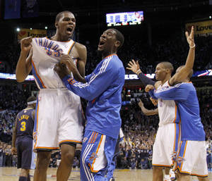 Photo - Oklahoma City's Kevin Durant (35) reacts with Oklahoma City's Royal Ivey (7) after the NBA basketball game between the Denver Nuggets and the Oklahoma City Thunder in the first round of the NBA playoffs at the Oklahoma City Arena, Wednesday, April 27, 2011. Photo by Bryan Terry, The Oklahoman