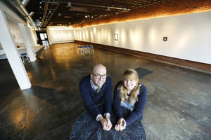Photo - Jonathan Fowler, vice president of Fowler Auto Group, and Kendall Brown, director of IAO Gallery, discuss a pop-up indoor park that opens Friday (in the gallery shown in the foreground). Photo by Steve Gooch, The Oklahoman <strong>Steve Gooch</strong>