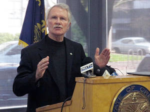 Photo - In this Nov. 1, 2013 file photo, Oregon Gov. John Kitzhaber discusses problems with the website for Cover Oregon, the state's health insurance exchange, during a news conference in Portland, Ore. More than a month after Cover Oregon was supposed to launch, reality is lagging far behind Gov. Kitzhaber's ideals. The online system still doesn't work, and the exchange has yet to enroll a single person in health insurance. Interviews with state officials and a review of public records suggests Cover Oregon officials bit off more than they could chew and clung stubbornly to their ambitious vision even when their risk management consultants raised alarms. (AP Photo/Jonathan J. Cooper, File)