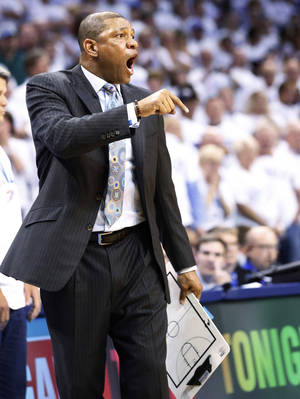 Photo - Los Angeles Clippers head coach Doc Rivers shouts at an official in the fourth quarter of Game 5 of the Western Conference semifinal NBA basketball playoff series against the Oklahoma City Thunder in Oklahoma City, Tuesday, May 13, 2014. Oklahoma City won 105-104. (AP Photo)