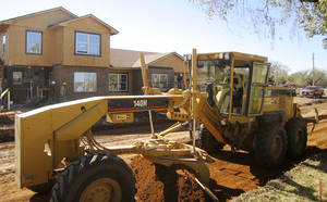 Photo - Contruction crews built houses on Fort Sill in 2005-06. Oklahoman Archive Photo.