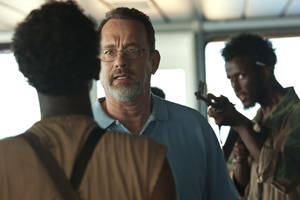 "Photo - This film image released by Sony - Columbia Pictures shows Tom Hanks, center, in a scene from ""Captain Phillips.""   (AP Photo/Sony - Columbia Pictures) ORG XMIT: NYET121"