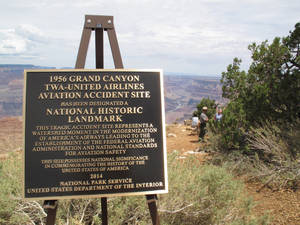 Photo - A plaque marking the designation of a 1956 commercial airliner collision over the Grand Canyon in northern Arizona is displayed on Tuesday, July 8, 2014. About 200 people gathered at the canyon to attend the unveiling of the plaque. (AP Photo/Felicia Fonseca)