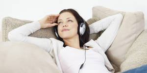 Photo - Young girl listening to music at home