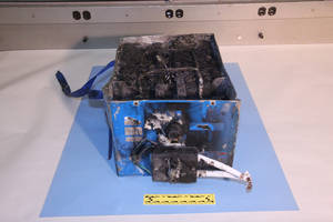 Photo - This undated image provided by the National Transportation Safety Board shows the burned auxiliary power unit battery from a JAL Boeing 787 that caught fire on Jan. 7, 2013, at Boston's Logan International Airport.  Federal officials said on Wednesday, Jan. 16, 2013, that they are temporarily grounding Boeing's 787 Dreamliners until the risk of possible battery fires is addressed. (AP Photo/National Transportation Safety Board)