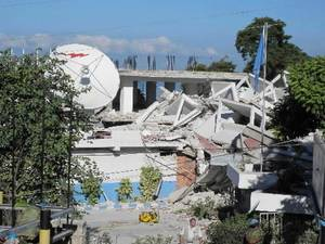 Photo - In this Wednesday, Jan. 13, 2010 photo released by the Philippine Mission to the United Nations, police officers from the United Nations inspect what was left of the United Nations Police Headquarters in Port-au-Prince, a day after a 7.0-magnitude quake shook  Haiti. (AP Photo/Philippine Mission to the United Nations)