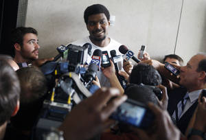 Photo -   Philadelphia 76ers' Andrew Bynum speaks to the media in Philadelphia, Wednesday, Aug. 15, 2012. ,Bynum was traded to the 76ers from the Los Angeles Lakers. (AP Photo/Brynn Anderson)