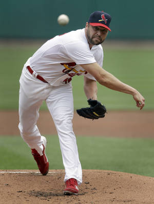 Photo -   St. Louis Cardinals starting pitcher Jake Westbrook throws during the second inning of a baseball game against the Chicago Cubs on Sunday, April 15, 2012, in St. Louis. (AP Photo/Jeff Roberson)