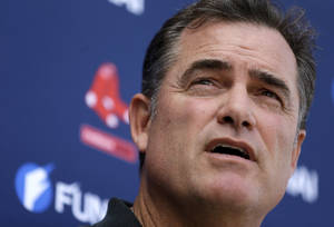 Photo - Boston Red Sox manager John Farrell speaks with reporters at spring training baseball Saturday, Feb. 15, 2014, in Fort Myers, Fla. (AP Photo/Steven Senne)