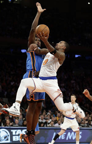 photo - New York Knicks&#039; J.R. Smith (8) drives past Oklahoma City Thunder&#039;s Serge Ibaka during the first half of an NBA basketball game Thursday, March 7, 2013, in New York.  (AP Photo/Frank Franklin II)