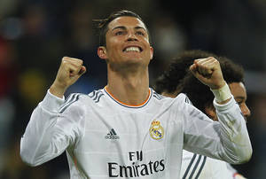 Photo - Real Madrid's Cristiano Ronaldo from Portugal celebrates his goal during a Spanish La Liga soccer match between Real Madrid and Celta at the Santiago Bernabeu stadium in Madrid, Spain, Monday, Jan. 6, 2014. (AP Photo/Andres Kudacki)