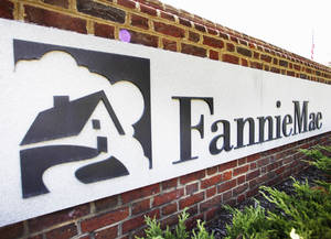 Photo - FILE - This Monday, Aug. 8, 2011 file photo shows the Fannie Mae headquarters in Washington. Fannie Mae reports quarterly results for the January-March 2014 quarter on Thursday, May 8, 2014. (AP Photo/Manuel Balce Ceneta, File)