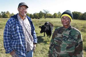 Photo - Mike Oakley and his sister Ruby Tucker are shown on their family's farm near Oktaha.  <strong>David McDaniel - The Oklahoman</strong>