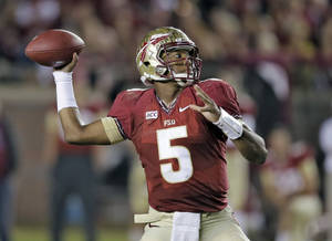 Photo - FILE - In this Nov. 2, 2013 file photo, Florida State quarterback Jameis Winston throws a pass during the third quarter of an NCAA college football game against Miami, in Tallahassee, Fla. (AP Photo/Chris O'Meara, File)