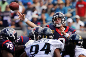 photo -   Houston Texans quarterback Matt Schaub (8) throws a pass over Jacksonville Jaguars defensive end Jeremy Mincey (94) and defensive end Tyson Alualu (93) during the second half an NFL football game, Sunday, Sept. 16, 2012, in Jacksonville, Fla. Houston won 27-7. (AP Photo/Stephen Morton)