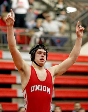 Photo - Union's Chance Wenglewski celebrates his win in the 6A 220-pound class during the finals of the State dual wrestling championship at Yukon High School in Yukon, Okla., Saturday, Feb. 11, 2012. Photo by Sarah Phipps, The Oklahoman
