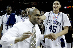 photo - Star Spencer's John Cooksey celebrates with head coach Patrick Cudjoe after the Bobcats won the boys  4A final between over McGuinness at the Lloyd Noble Center, Saturday, March 14, 2009, in Norman, Okla. PHOTO BY SARAH PHIPPS, THE OKLAHOMAN