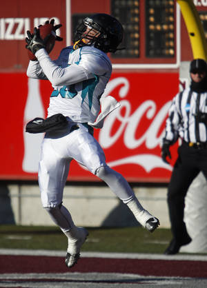 Photo - Coastal Carolina wide receiver Niccolo Mastromatteo (20) catches a touchdown pass in the second quarter against Montana in an NCAA college playoff football game in Missoula, Mont., Saturday, Dec. 7, 2013. (AP Photo/Michael Albans)