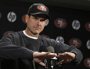 Photo - San Francisco 49ers coach Jim Harbaugh gestures during an NFL football news conference Tuesday, Jan. 21, 2014, in Santa Clara, Calif. (AP Photo/Ben Margot)