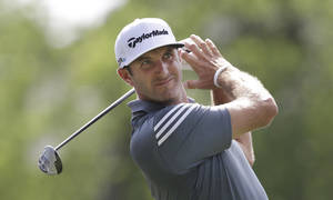 Photo - Dustin Johnson watches his tee shot on the 18th hole during the first round of the PGA Colonial golf tournament in Fort Worth, Texas, Thursday, May 22, 2014. (AP Photo/LM Otero)