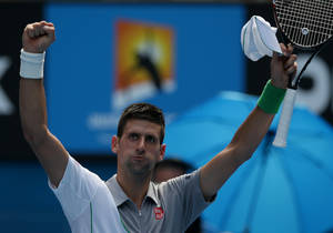 Photo - Novak Djokovic of Serbia waves to the crowd after winning his second round match against Leonardo Mayer of Argentina at the Australian Open tennis championship in Melbourne, Australia, Wednesday, Jan. 15, 2014.(AP Photo/Aaron Favila)