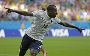 Photo - France's Blaise Matuidi celebrates after scoring his side's second goal during the group E World Cup soccer match between Switzerland and France at the Arena Fonte Nova in Salvador, Brazil, Friday, June 20, 2014. (AP Photo/Natacha Pisarenko)