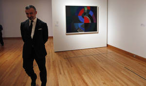 Photo -   In this photo taken Tuesday, Oct. 9, 2012, Alain Seban, president of the museum at the Pompidor Center, walks past an oil painting by Oil by Sonia Delaunay (Profound Rhythm, 1960), as part of one of two new exhibits featuring art exclusively by women at the Seattle Art Museum, in Seattle. Included in the exhibition is the only U.S. stop for an exhibit from the Pompidou Center in Paris, home of the modern art museum there, of painting, sculpture, drawing, photography and video. The exhibit runs through Jan. 13, 2013. (AP Photo/Elaine Thompson)